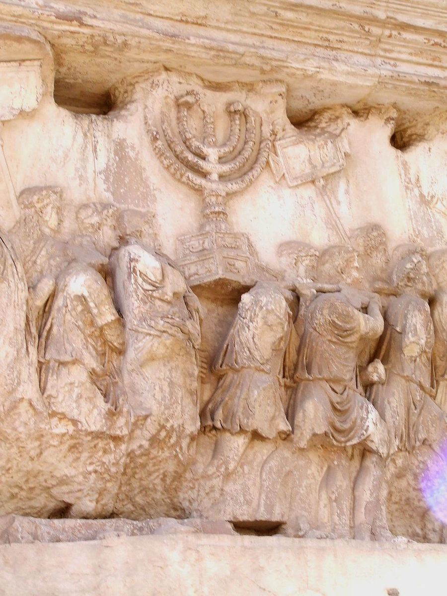 Standard 1024px carrying off the menorah from the temple in jerusalem depicted on a frieze on the arch of titus in the forum romanum